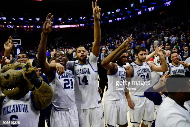 Dhamir CosbyRoundtree Omari Spellman Mikal Bridges and Tim Delaney of the Villanova Wildcats celebrate the win over the Xavier Musketeers after the...