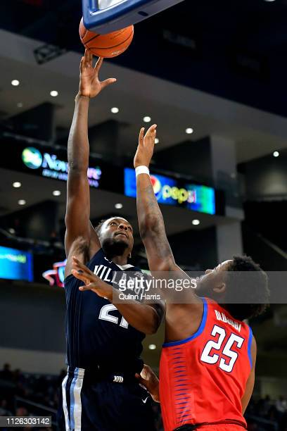 Dhamir CosbyRoundtree shoots against Femi Olujobi of the DePaul Blue Demons at Wintrust Arena on January 30 2019 in Chicago Illinois