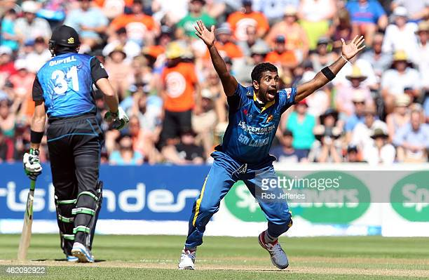 Dhammika Prasad of Sri Lanka appeals for the wicket of Martin Guptill of New Zealand during the One Day International match between New Zealand and...
