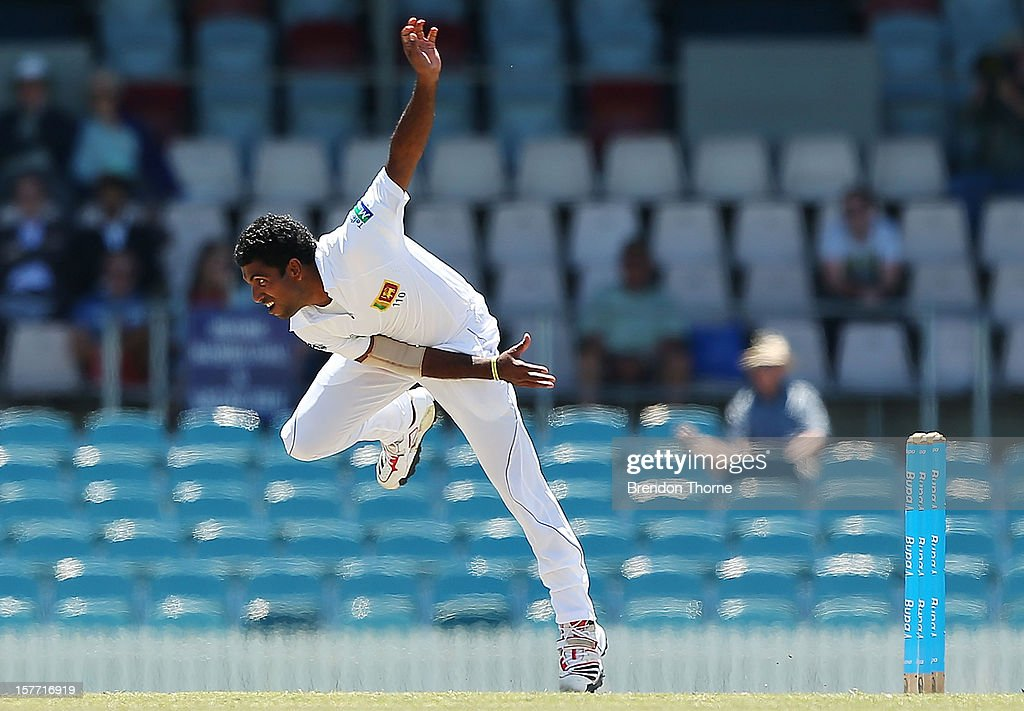 Dhammika Prasad of Sri Lanka bowls during day one of the international tour match between the Chairman's XI and Sri Lanka at Manuka Oval on December 6, 2012 in Canberra, Australia.