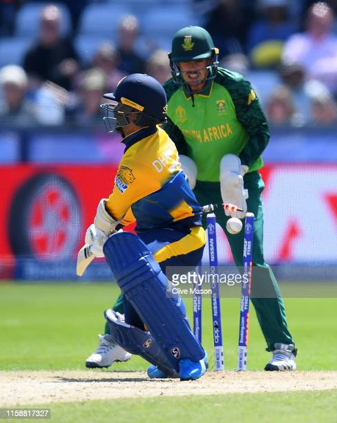 Dhanajaya de Silva of Sri Lanka is dismissed of the bowling of JP Duminy of South Africa during the Group Stage match of the ICC Cricket World Cup...