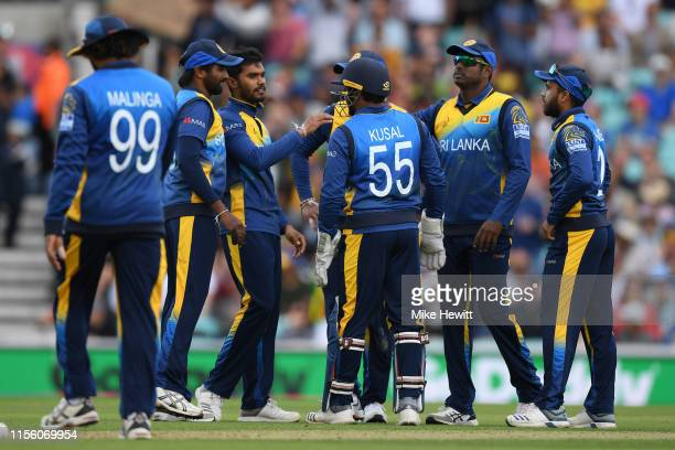 Dhananjaya de Silva of Sri Lanka celebrates with team mates after bowling David Warner of Australia during the Group Stage match of the ICC Cricket...