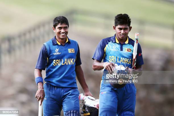 Dhananjaya Lakshan and Kamindu Mendis of Sri Lanka walk off the field after winning the ICC U19 Cricket World Cup match between Sri Lanka and Ireland...
