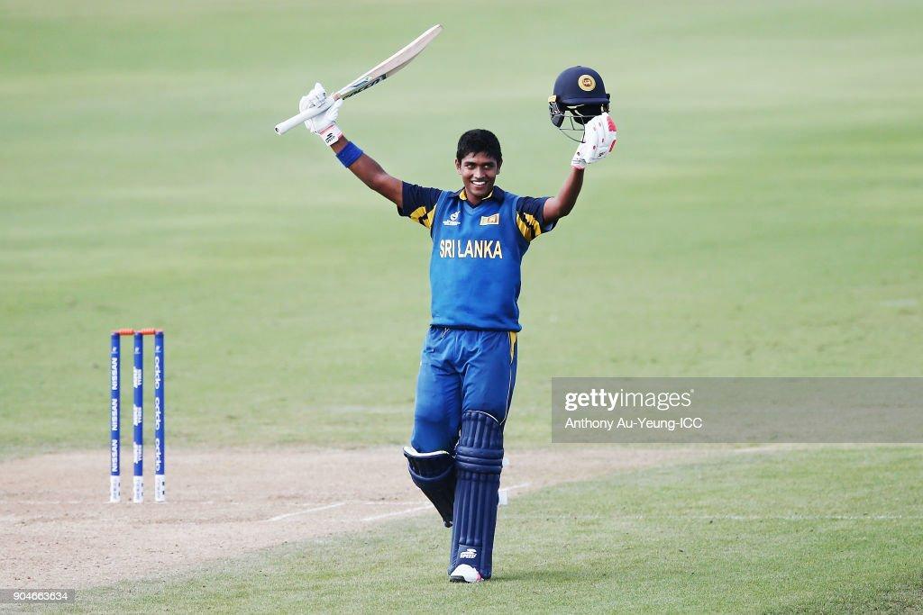 Dhananjaya Lakshan of Sri Lanka celebrates scoring a century during the ICC U19 Cricket World Cup match between Sri Lanka and Ireland at Cobham Oval on January 14, 2018 in Whangarei, New Zealand.