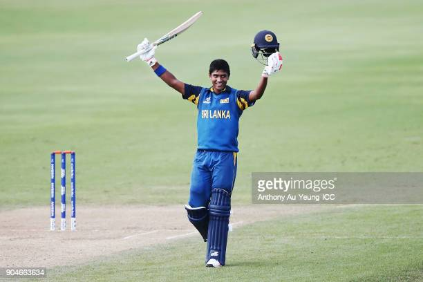 Dhananjaya Lakshan of Sri Lanka celebrates scoring a century during the ICC U19 Cricket World Cup match between Sri Lanka and Ireland at Cobham Oval...