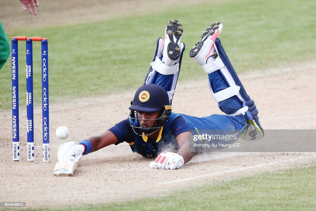 Dhananjaya Lakshan of Sri Lanka dives to make his ground during the ICC U19 Cricket World Cup match between Sri Lanka and Ireland at Cobham Oval on January 14, 2018 in Whangarei, New Zealand.