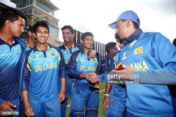Dhananjaya Lakshan of Sri Lanka is congratulated after receiving his Man of the Match medallion after winning the ICC U19 Cricket World Cup match...