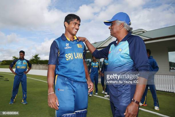 Dhananjaya Lakshan of Sri Lanka is congratulated with his Man of the Match performance after winning the ICC U19 Cricket World Cup match between Sri...