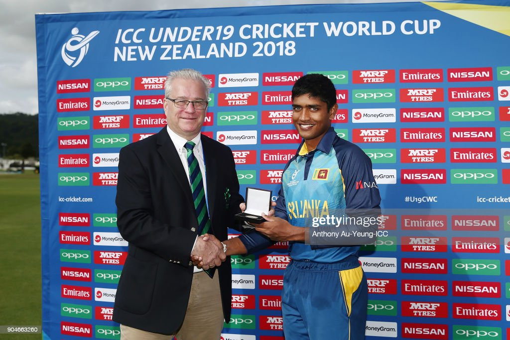Dhananjaya Lakshan of Sri Lanka is presented with the Man of the Match medallion by Chairman of Cricket Ireland Ross McCollum after the ICC U19 Cricket World Cup match between Sri Lanka and Ireland at Cobham Oval on January 14, 2018 in Whangarei, New Zealand.