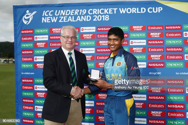Dhananjaya Lakshan of Sri Lanka is presented with the Man of the Match medallion by Chairman of Cricket Ireland Ross McCollum after the ICC U19...