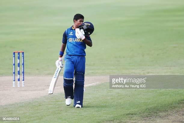 Dhananjaya Lakshan of Sri Lanka kisses his helmet to celebrate scoring a century during the ICC U19 Cricket World Cup match between Sri Lanka and...