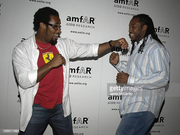 Dhani Jones and Lennox Lewis during 14th Annual amfAR Rocks Benefit at Tavern on The Green at Tavern on The Green in New York City New York United...