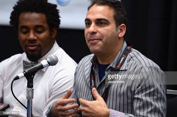 Dhani Jones, host of Spike.com and moderator Adam Lilling speak onstage at The New ROI: Return On Influence - How Influencers Should Leverage Their...