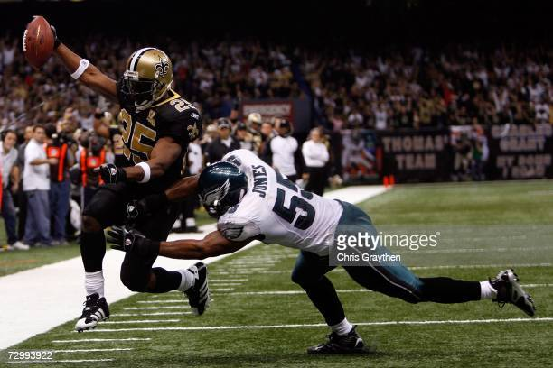 Dhani Jones of the Philadelphia Eagles fails to stop Reggie Bush of the New Orleans Saints from scoring a touchdown during the NFC divisional playoff...
