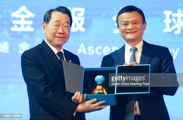 Dhanin Chearavanont chairman and CEO of Charoen Pokphand Group and Jack Ma Yun chairman of Alibaba Group Holding Ltd exchange gifts during Ant...