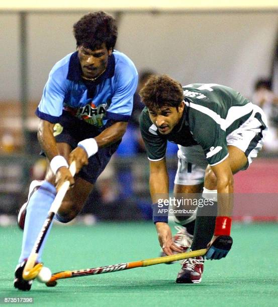 Dhanraj Pillay of India and Mohammad Saqlain of Pakistan battle for the ball during the match between Pakistan and India in the 6th Men's Asia Cup...