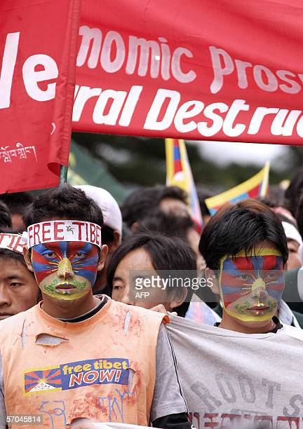 Tibetan refugees with Tibetan flag painted over their faces attend a function marking the 47th anniversary of the Tibetan uprising against Chinese...