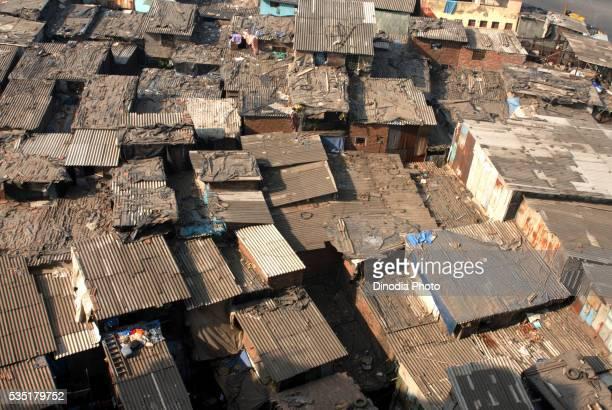 dharavi slums in mumbai, maharashtra, india. - indian slums stock pictures, royalty-free photos & images