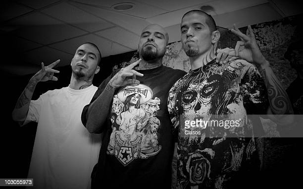Dharius MC Babo and Rowan Rabia of the hip hop group Cartel de Santa pose for a photograph after a press conference to present their new album...