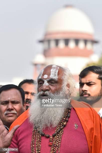 Dharm Das Maharaj of the Akhil Bharatiya Panch Ramanandi Nirmani Ani Akhara addresses the media in the presence of lawyers after the hearing, near...