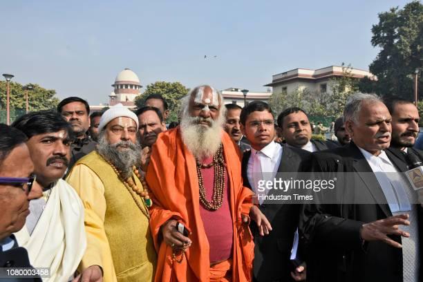Dharm Das Maharaj of the Akhil Bharatiya Panch Ramanandi Nirmani Ani Akhara and lawyers address the media after the hearing, near the Supreme Court...