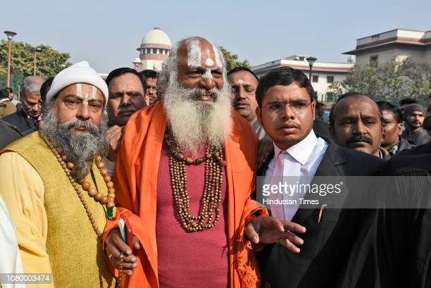 Dharm Das Maharaj of the Akhil Bharatiya Panch Ramanandi Nirmani Ani Akhara addresses the media in the presence of lawyers after the hearing, near...