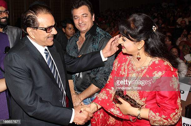 Dharmendra greets Upasna Singh at Baisakhi Celebration cohosted by G S Bawa and Punjab Association Of India on April 13 2013 in Mumbai India