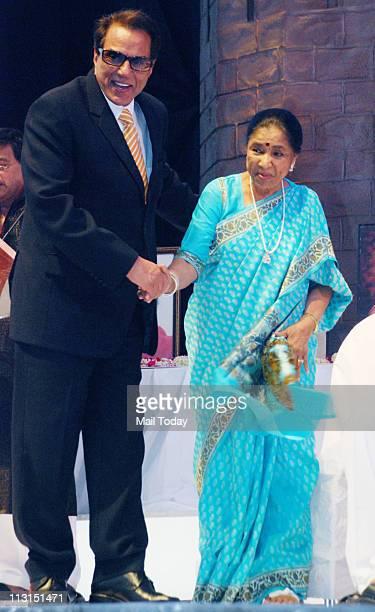 Dharmendra with Asha Bhosle during Shiv Gaurav Puraskar 2011 held at Thane Mumbai on April 24 2011