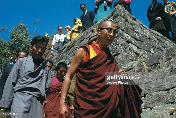 The Dalai Lama shown with crowds during celebration of 10th anniversary of the Tibetan uprising against the Chinese Reds and subsequent exile March...