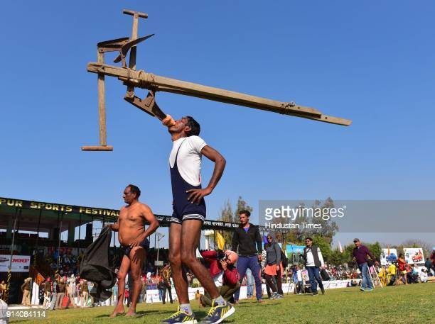 Dheera Singh lifting plough showing the skills on the 2nd day of the 82nd Kila Raipur Rural Olympics 2018 in the village Kila Raipur on February 3 in...