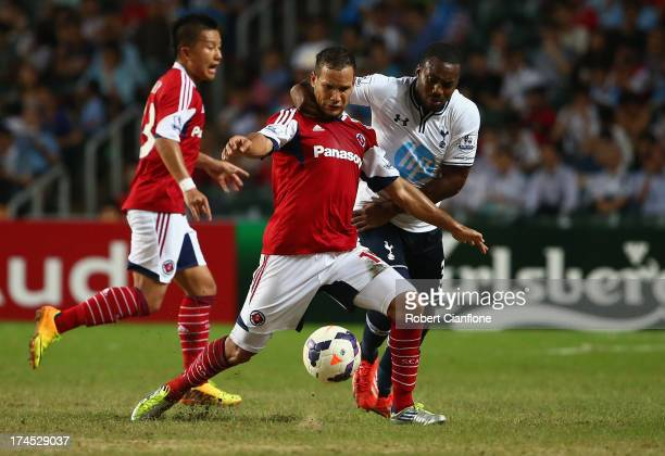 Dhiego De Souza Martins of South China is challenged by Daniel Rose of Tottenhan Hotspur during the Third Place PlayOff match between Tottenham...