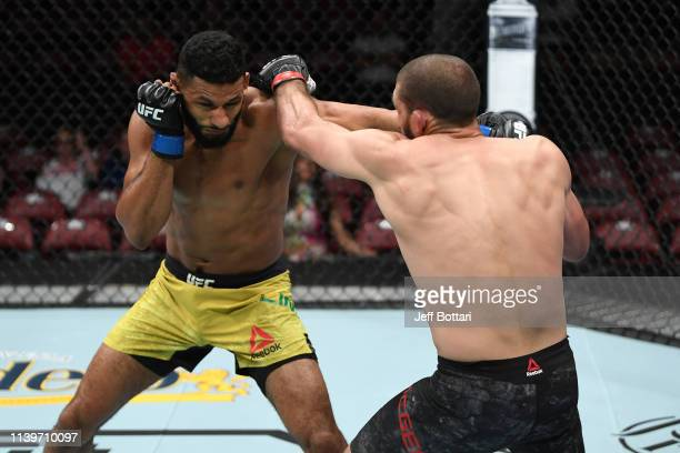 Dhiego Lima of Brazil and Court McGee exchange punches in their welterweight bout during the UFC Fight Night event at BBT Center on April 27 2019 in...