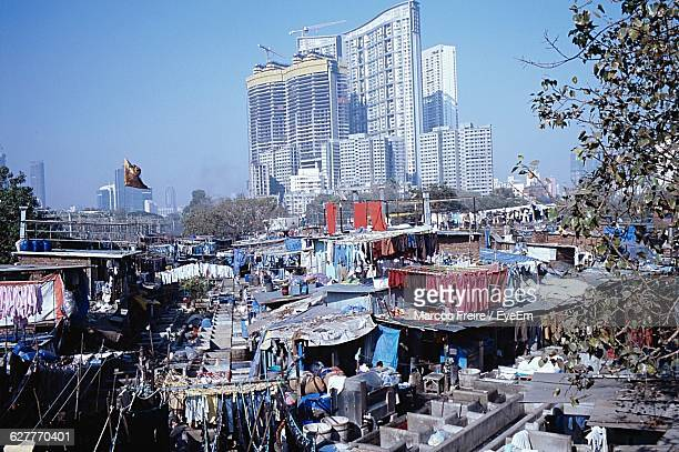 Dhobi Ghat By Modern Buildings Against Clear Blue Sky