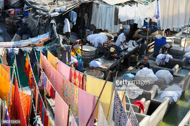 Dhobi Ghat in Mumbai Dhobis or launderers run from door to door collecting dirty linen from households and hotels for laundering at the Dhobi Ghats...