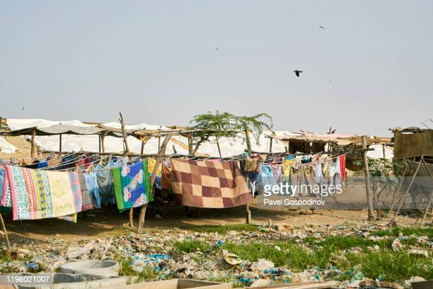 dhobi ghat, the washing wharf on the banks of the lyari river in karachi, pakistan - ghetto trash stock pictures, royalty-free photos & images