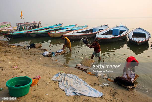 Dhobis busy washing clothes on the banks of the river Ganges in Varanasi, Uttar Pradesh, India.