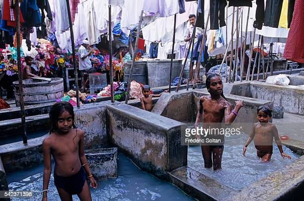 Dhobis or launderers run from door to door collecting dirty linen from households and hotels for laundering at the Dhobi Ghats or washing places