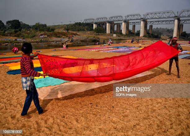 Dhobis seen spreading the clothes on the soil next to the river bank of Barakar in Jharkhand area The Dhobi Ghat of Kumardubi in the Jharkhand...