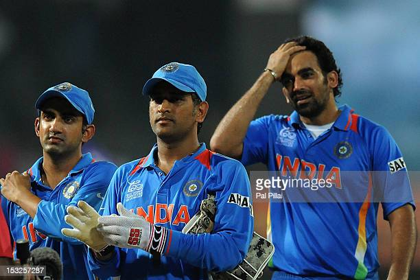 Dhoni along with teammates Gautam Gambhir and Zaheer Khan of India walk back to the pavilion after the game during the ICC World Twenty20 2012 Super...