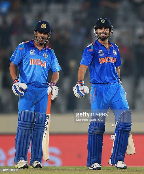 Dhoni and Virat Kohli of India look on during the ICC World Twenty20 Bangladesh 2014 Semi Final match between India and South Africa at ShereBangla...