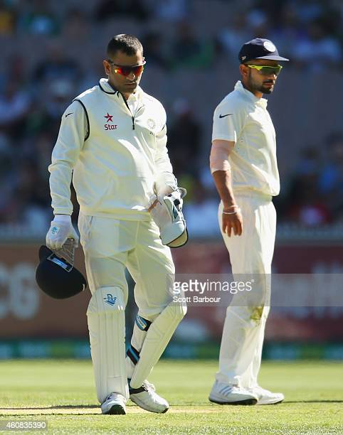 Dhoni and Virat Kohli of India look on in the field during day one of the Third Test match between Australia and India at Melbourne Cricket Ground on...