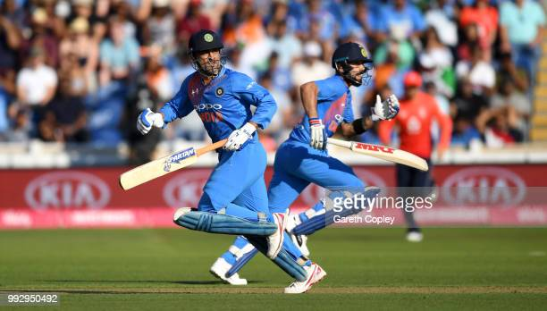 Dhoni and Virat Kohli of India score runs during the 2nd Vitality International T20 match between England and India at SWALEC Stadium on July 6 2018...