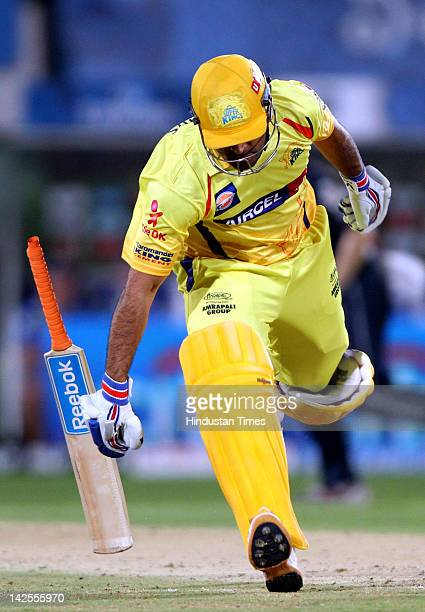 Dhoni captain of Chennai Super Kings drops his bat as he runs into the crease while taking a run during the IPL Indian Premier league 2012 cricket...