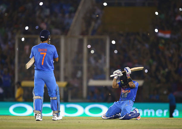Dhoni Captain of India and Virat Kohli of India celebrate victory during the ICC WT20 India Group 2 match between India and Australia at IS Bindra...