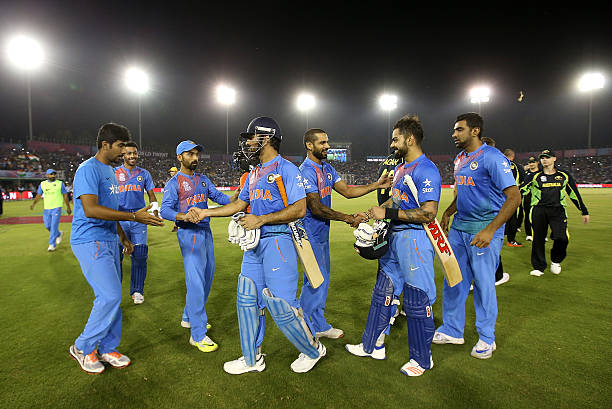 Dhoni Captain of India and Virat Kohli of India celebrate with team mates during the ICC World Twenty20 India 2016 Super 10s Group 2 match between...