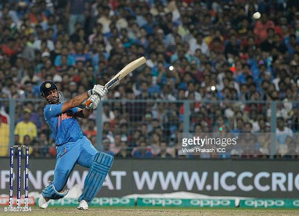 Dhoni, Captain of India, hits a shot during the ICC World Twenty20 India 2016 match betweenPakistan and India at Eden Gardens on March 19, 2016 in...