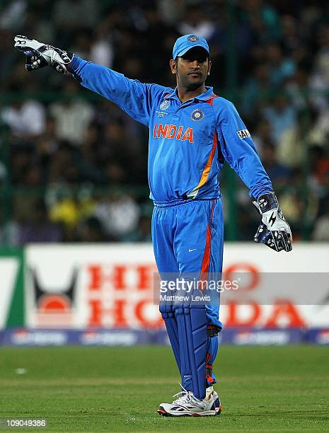 Dhoni, Captain of India in action during the 2011 ICC World Cup Warm up game between India and Australia at the M. Chinnaswamy Stadium on February...