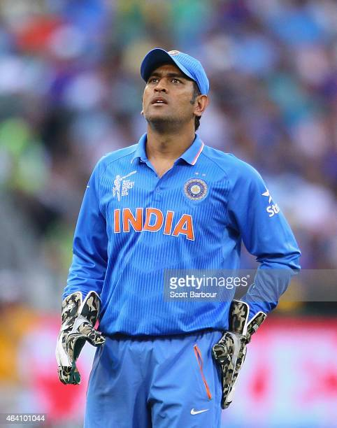 Dhoni, captain of India looks on after South Africa hit a boundary during the 2015 ICC Cricket World Cup match between South Africa and India at...