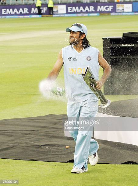 Dhoni celebrates with Trophy and Champagne as India celebrates their Victory during the final match of the ICC Twenty20 World Cup between Pakistan...