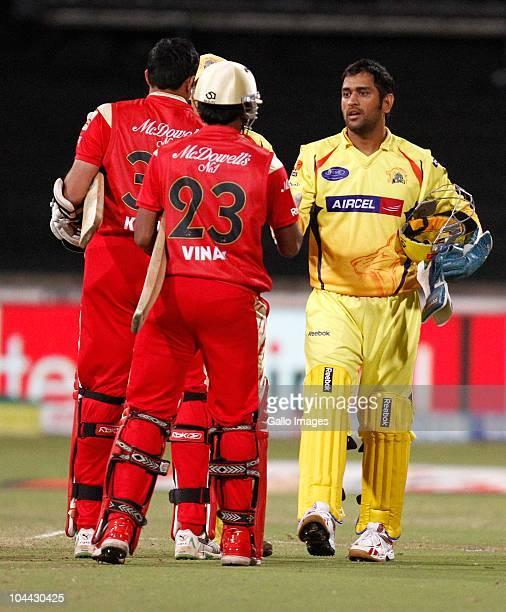 Dhoni congratulates Vinay Kumar and Anil Kumble during the Airtel Champions League Twenty20 semifinal match between Chennai Super Kings and Royal...